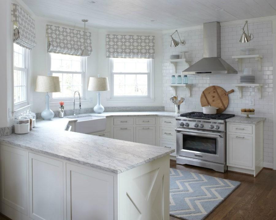 antique_white_kitchen_cabinets_with_black_granite_countertops