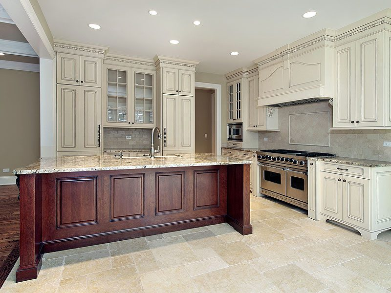 antique_white_kitchen_cabinets_with_dark_granite_countertops
