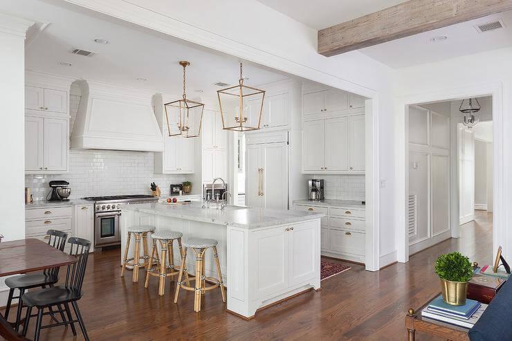 antique_white_kitchen_cabinets_with_dark_island