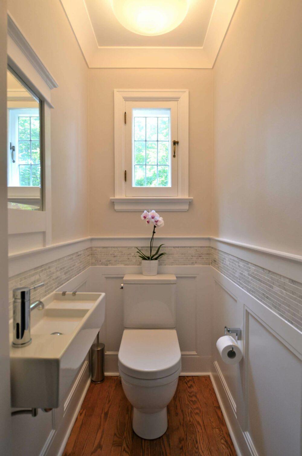 bathroom with wainscoting and tile