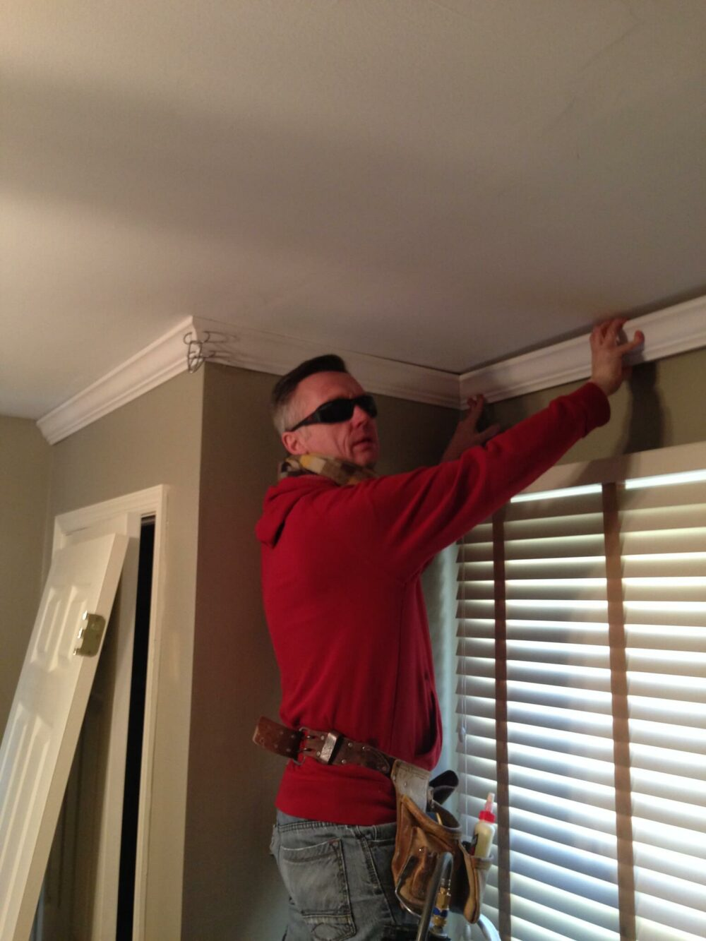 man installing crown molding