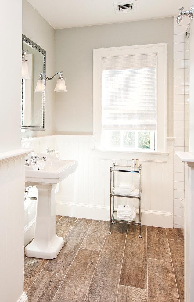 small bathroom with wainscoting